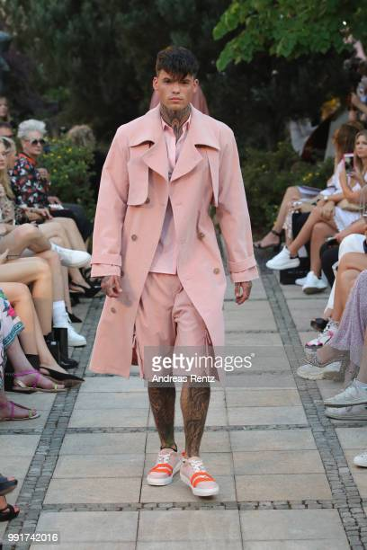 A model walks the runway at the Marcel Ostertag show during the Berlin Fashion Week Spring/Summer 2019 at Westin Grand Hotel on July 4 2018 in Berlin...