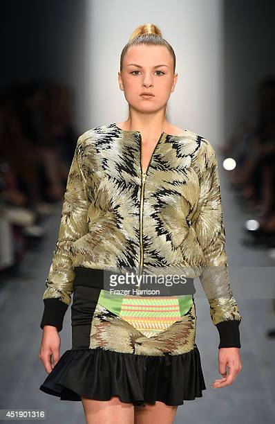 A model walks the runway at the Marcel Ostertag show during the MercedesBenz Fashion Week Spring/Summer 2015 at Erika Hess Eisstadion on July 9 2014...