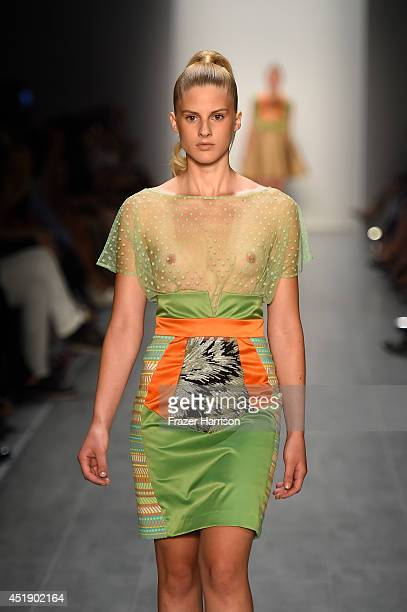 Model walks the runway at the Marcel Ostertag show during the Mercedes-Benz Fashion Week Spring/Summer 2015 at Erika Hess Eisstadion on July 9, 2014...