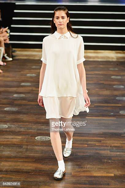 A model walks the runway at the Marcel Ostertag show during the MercedesBenz Fashion Week Berlin Spring/Summer 2017 at Admiralspalast on June 30 2016...