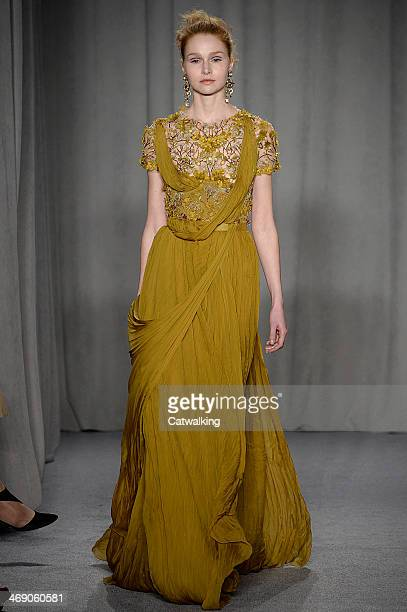 A model walks the runway at the Marchesa Autumn Winter 2014 fashion show during New York Fashion Week on February 12 2014 in New York United States