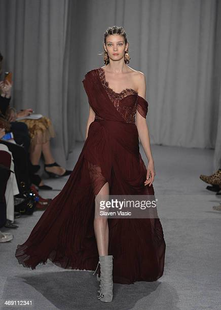 A model walks the runway at the Marchesa fashion show during MercedesBenz Fashion Week Fall 2014 at New York Public Library on February 12 2014 in...