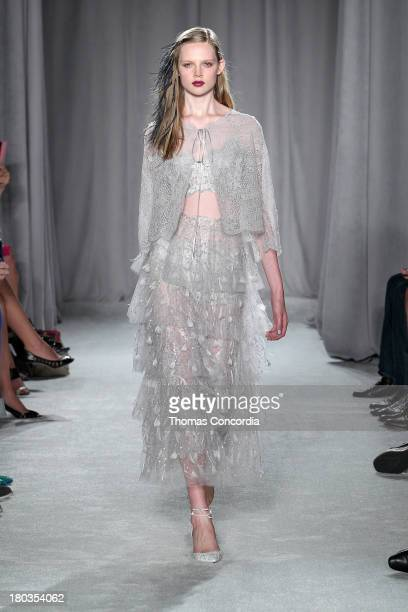 A model walks the runway at the Marchesa show during Spring 2014 MercedesBenz Fashion Week at New York Public Library on September 11 2013 in New...