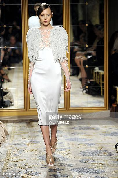 Model walks the runway at the Marchesa Spring 2012 fashion show during Mercedes-Benz Fashion Week at The Plaza Hotel on September 13, 2011 in New...