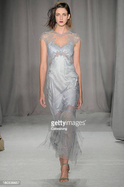 A model walks the runway at the Marchesa Spring Summer 2014 fashion show during New York Fashion Week on September 11 2013 in New York United States