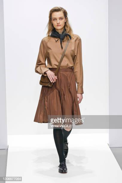 Model walks the runway at the Margaret Howell Ready to Wear Fall/Winter 2020-2021 fashion show during London Fashion Week on February 16, 2020 in...