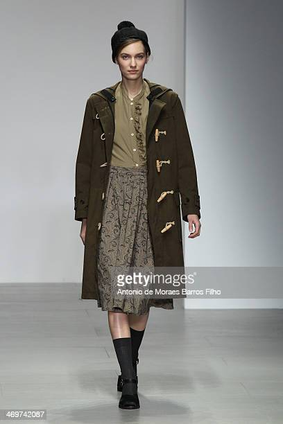 Model walks the runway at the Margaret Howell show at London Fashion Week AW14 at Somerset House on February 16, 2014 in London, England.