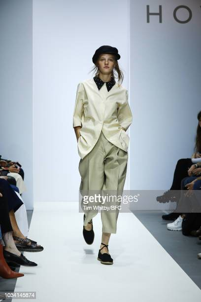 Model walks the runway at the Margaret Howell show during London Fashion Week September 2018 at XXXX on September 16, 2018 in London, England.