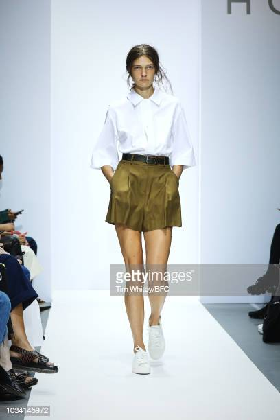 Model walks the runway at the Margaret Howell show during London Fashion Week September 2018 at Rambert on September 16, 2018 in London, England.