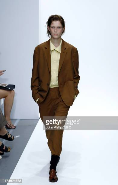 Model walks the runway at the Margaret Howell show during London Fashion Week September 2019 at Rambert on September 15, 2019 in London, England.
