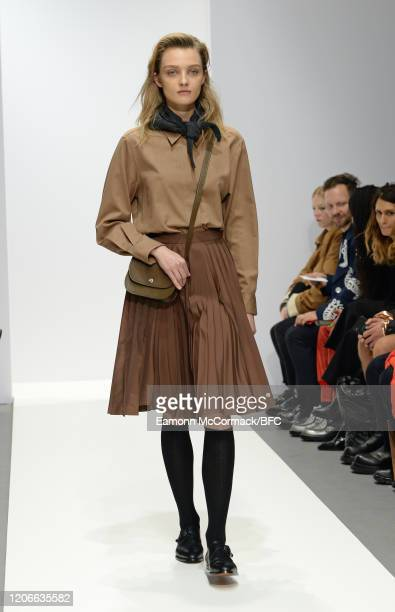 Model walks the runway at the Margaret Howell show during London Fashion Week February 2020 on February 16, 2020 in London, England.