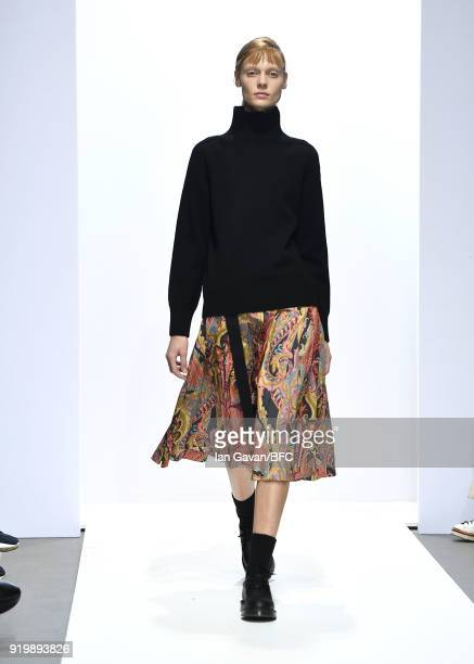Model walks the runway at the Margaret Howell show during London Fashion Week February 2018 at Rambert on February 18, 2018 in London, England.