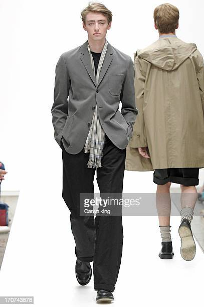 Model walks the runway at the Margaret Howell Spring Summer 2014 fashion show during London Menswear Fashion Week on June 17, 2013 in London, United...