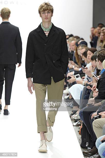 Model walks the runway at the Margaret Howell Spring Summer 2015 fashion show during London Menswear Fashion Week on June 16, 2014 in London, United...