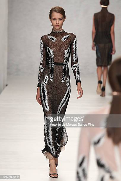 Model walks the runway at the Marios Schwab show during London Fashion Week SS14 at TopShop Show Space on September 16, 2013 in London, England.