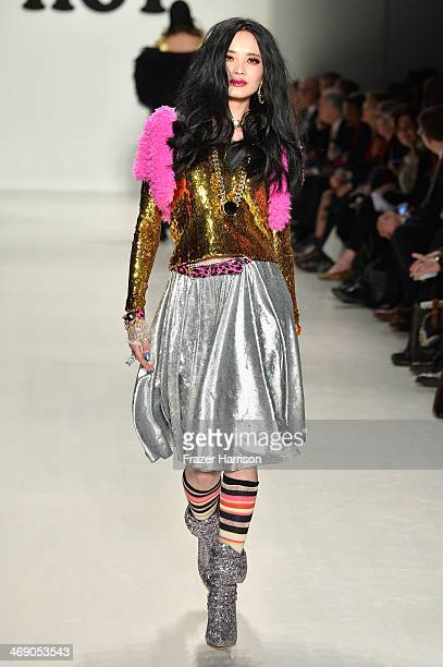 A model walks the runway at the Marist College Presents Betsey Johnson Reprise fashion show during MercedesBenz Fashion Week Fall 2014 at The Salon...