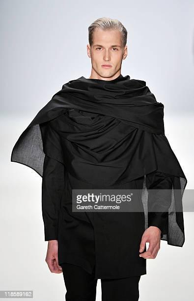 A model walks the runway at the Mariusz Przybylski Show during MercedesBenz Fashion Week Berlin Spring/Summer 2012 at the Brandenburg Gate on July 9...