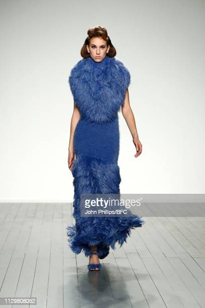 Model walks the runway at the Mark Fast show during London Fashion Week February 2019 at the BFC Show Space on February 15, 2019 in London, England.