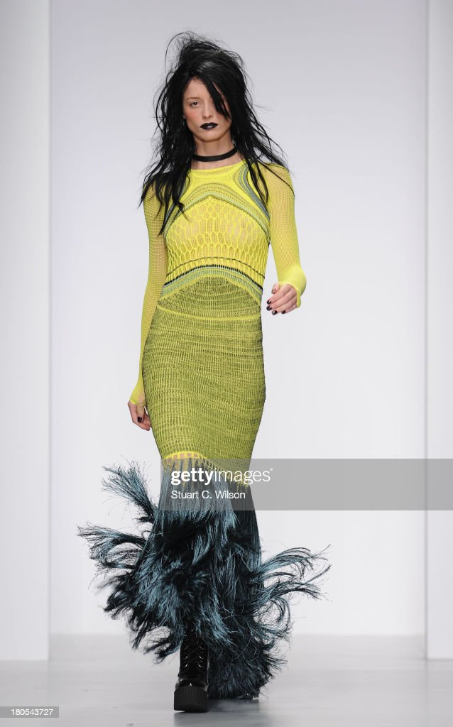 A model walks the runway at the Mark Fast show during London Fashion Week SS14 at BFC Courtyard Showspace on September 14, 2013 in London, England.
