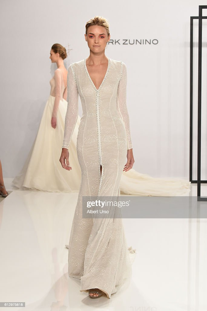 on sale 675b5 28f8f A model walks the runway at the Mark Zunino For Kleinfeld ...