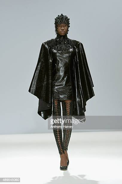 Model walks the runway at the Marko Mitanovski show at Fashion Scout during London Fashion Week Spring/Summer 2016 on September 22, 2015 in London,...