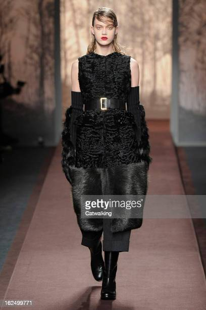 A model walks the runway at the Marni Autumn Winter 2013 fashion show during Milan Fashion Week on February 24 2013 in Milan Italy