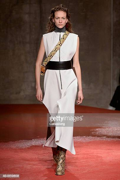 A model walks the runway at the Marni Autumn Winter 2015 fashion show during Milan Fashion Week on March 1 2015 in Milan Italy