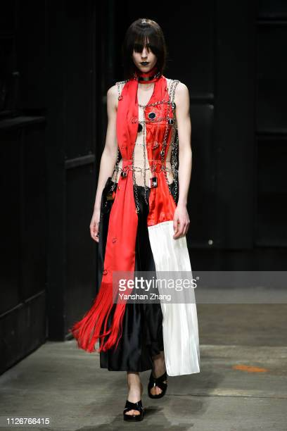 A model walks the runway at the Marni show at Milan Fashion Week Autumn/Winter 2019/20 on February 22 2019 in Milan Italy