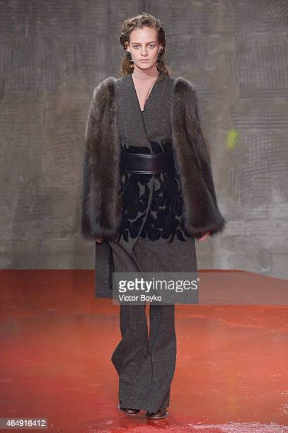 A model walks the runway at the Marni show during the Milan Fashion Week Autumn/Winter 2015 on March 1 2015 in Milan Italy