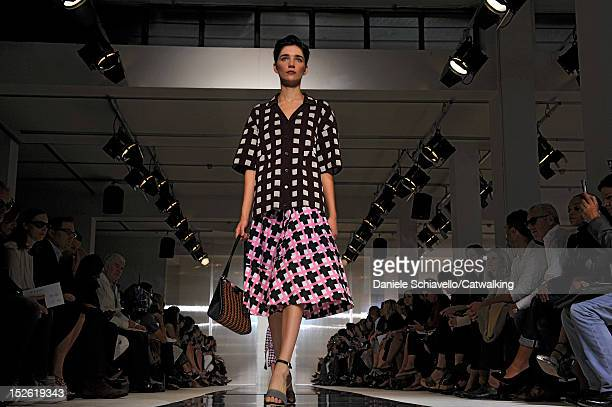 Model walks the runway at the Marni Spring Summer 2013 fashion show during Milan Fashion Week on September 23, 2012 in Milan, Italy.