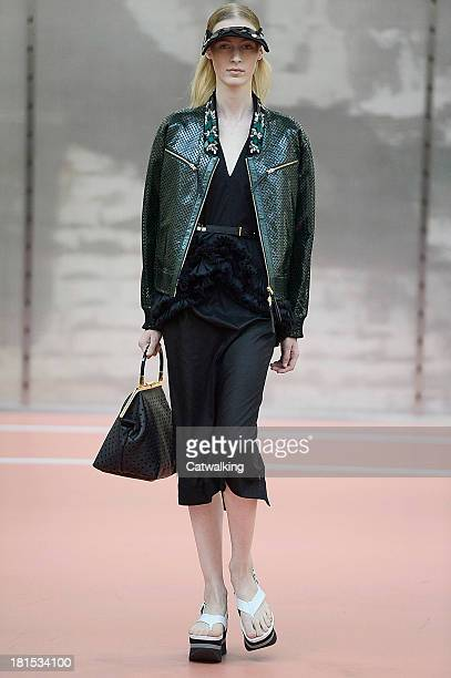 A model walks the runway at the Marni Spring Summer 2014 fashion show during Milan Fashion Week on September 22 2013 in Milan Italy