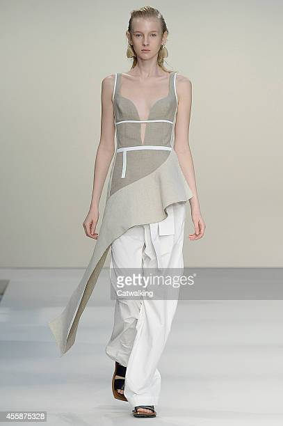 Model walks the runway at the Marni Spring Summer 2015 fashion show during Milan Fashion Week on September 21, 2014 in Milan, Italy.