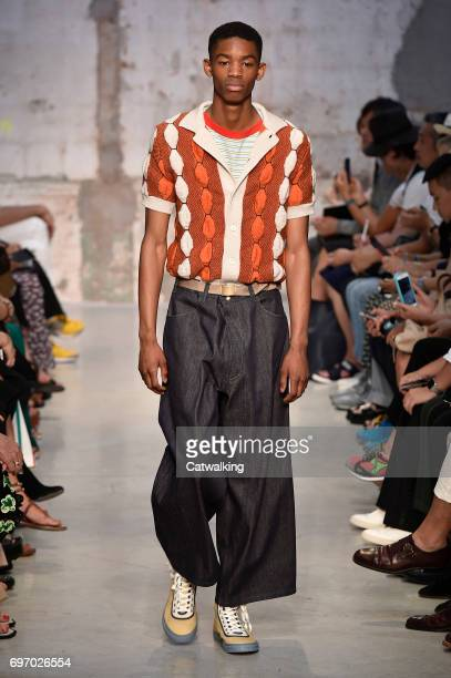 A model walks the runway at the Marni Spring Summer 2018 fashion show during Milan Menswear Fashion Week on June 17 2017 in Milan Italy