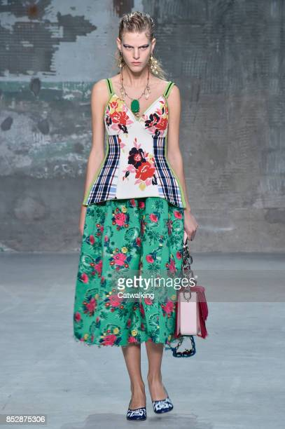 A model walks the runway at the Marni Spring Summer 2018 fashion show during Milan Fashion Week on September 24 2017 in Milan Italy