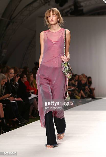 A model walks the runway at the Marques'Almeida show during London Fashion Week SS14 at TopShop Show Space on September 16 2013 in London England
