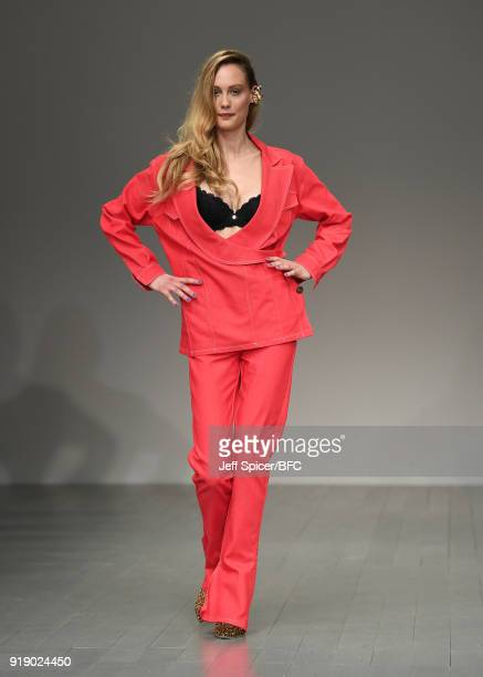 Model walks the runway at the Marta Jakubowski show during London Fashion Week February 2018 at BFC Show Space on February 16, 2018 in London,...