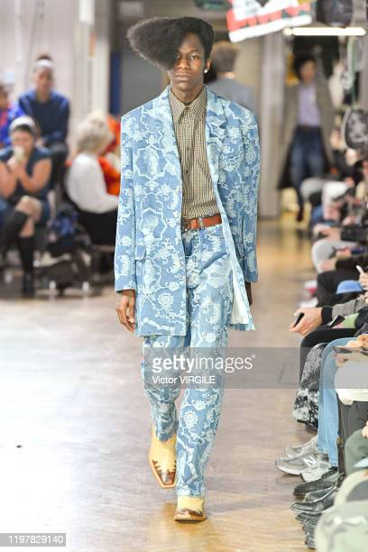 Model walks the runway at the Martine Rose Fall/Winter 2020-2021 fashion show during London Fashion Week Men's January 2020 on January 05, 2020 in...