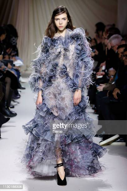 A model walks the runway at the Mary Katrantzou show during London Fashion Week February 2019 at the Coutts Garden Court on February 16 2019 in...
