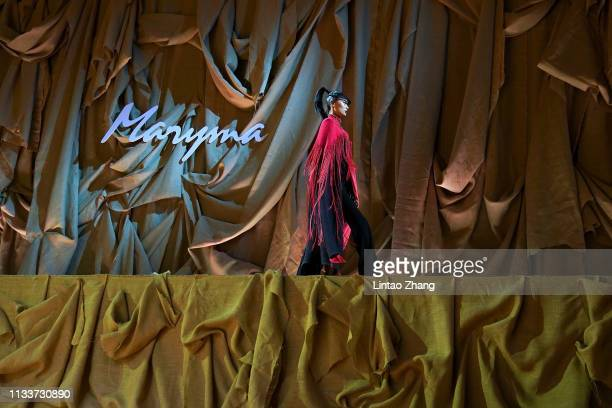 Model walks the runway at the Maryma collection show by Chinese designer Ma Yanli during the China Fashion Week A/W 2019/2020 on March 30, 2019 in...