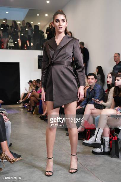 A model walks the runway at the Matt Sarafa and Jonathan Marc Stein's new 'Rich' clothing line release and fashion show on March 29 2019 in Los...