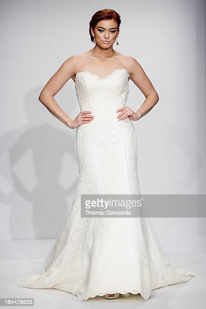 Model walks the runway at the Matthew Christopher Couture Fall 2014 Bridal collection show at the Hilton New York on October 13, 2013 in New York...