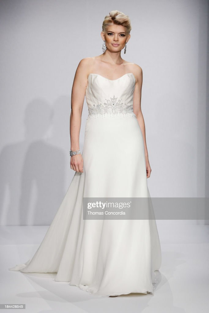 A model walks the runway at the Matthew Christopher Couture Fall 2014 Bridal collection show at the Hilton New York on October 13, 2013 in New York City.