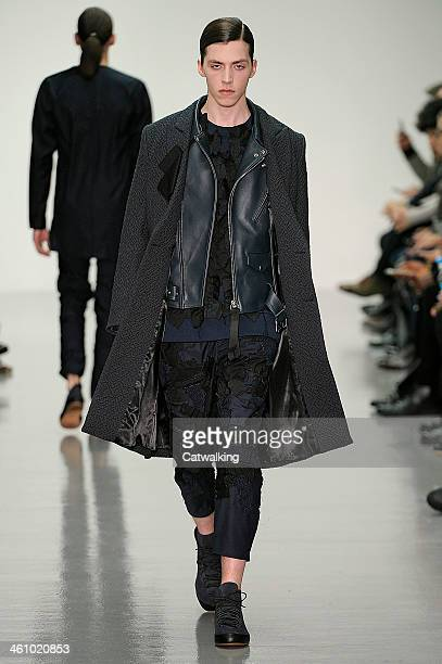 Model walks the runway at the Matthew Miller Autumn Winter 2014 fashion show during London Menswear Fashion Week on January 6, 2014 in London, United...