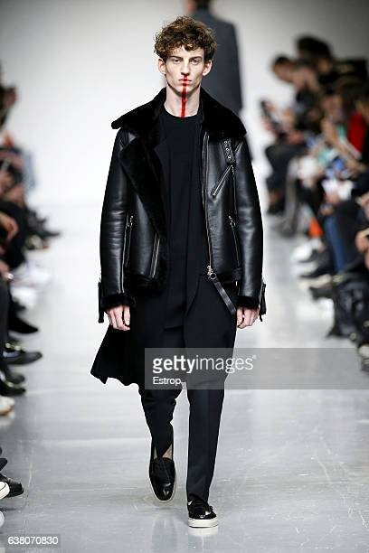 A model walks the runway at the Matthew Miller show during London Fashion Week Men's January 2017 collections at BFC Show Space on January 7 2017 in...