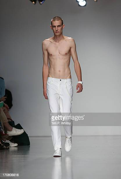 A model walks the runway at the Matthew Miller show during the London Collections MEN SS14 at Victoria House on June 18 2013 in London England