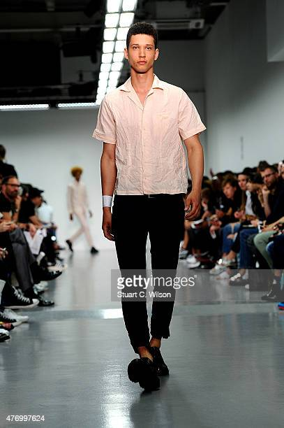 A model walks the runway at the Matthew Miller show during The London Collections Men SS16 at Victoria House on June 13 2015 in London England