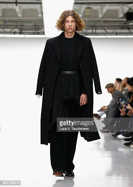 Model walks the runway at the Matthew Miller show during The London Collections Men AW16 at Victoria House on January 9, 2016 in London, England.