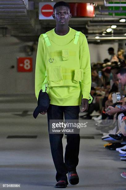 A model walks the runway at the Matthew Miller Spring/summer 2019 fashion show during London Fashion Week Men's June 2018 on June 9 2018 in London...