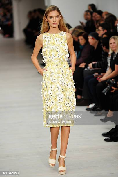 A model walks the runway at the Matthew Williamson show during London Fashion Week SS14 at on September 15 2013 in London England