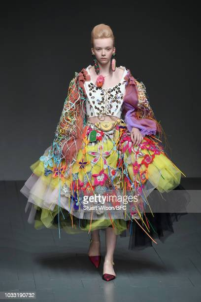 A model walks the runway at the Matty Bovan Show during London Fashion Week September 2018 at The BFC Show Space on September 14 2018 in London...